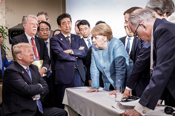 in-this-photo-provided-by-the-german-government-press-office-bpa-german-chancellor-angela-merkel-del_252351_ Дональд Трамп Германы канцлерь руу чихэр чулууджээ