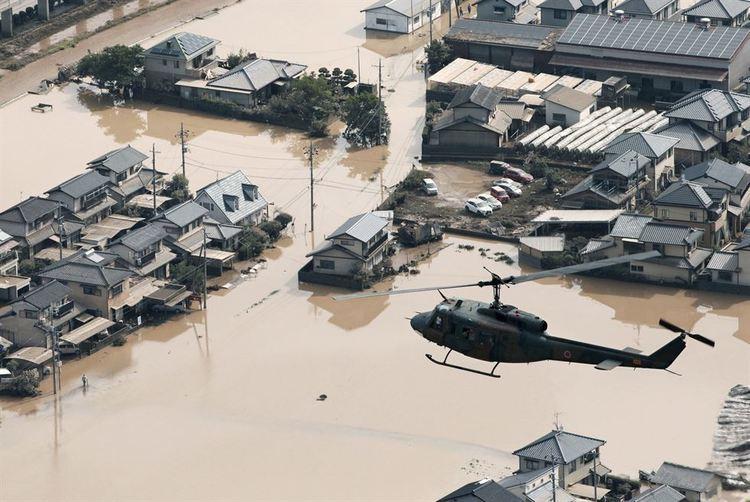 02_b Японд буусан үерийн улмаас 122 хүн амиа алдаад байна